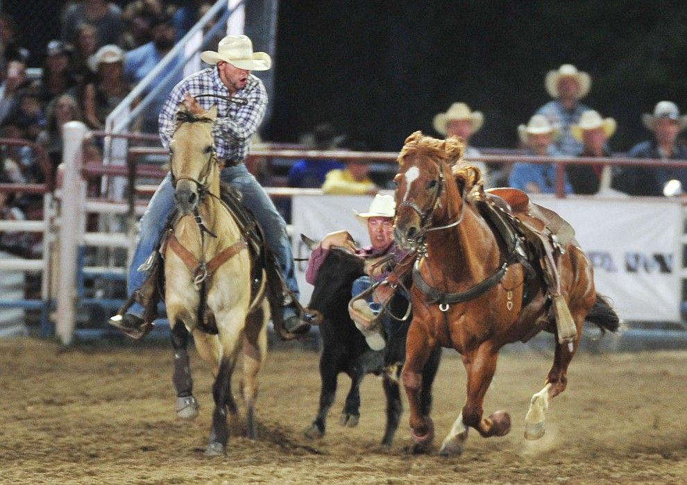 Cutter DeHart had a 15.8 second run in the steer wrestling during the opening performance of the Prescott Frontier Days Rodeo Thursday, June 28, 2018. (Les Stukenberg/Courier)