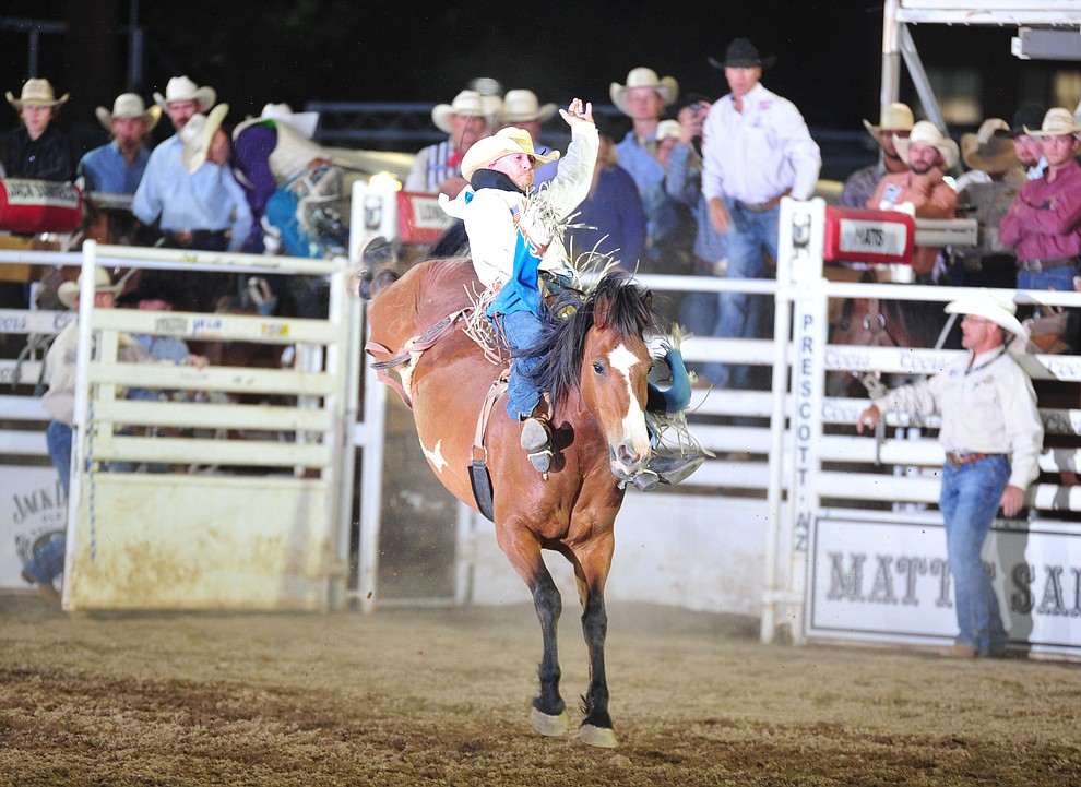 Seth Hardwick scored 78 on Spicy Chicken in the bareback during the opening performance of the Prescott Frontier Days Rodeo Thursday, June 28, 2018. (Les Stukenberg/Courier)