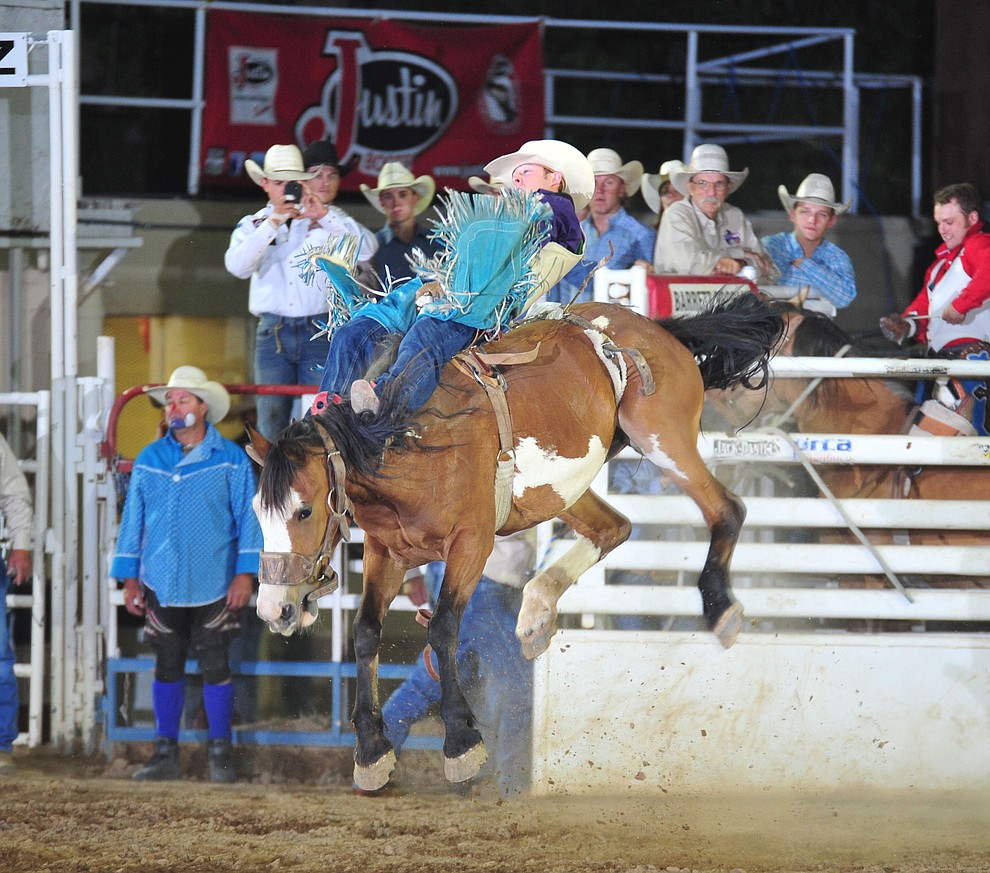 Zach Brown scored 80 on Angel Face in the bareback during the opening performance of the Prescott Frontier Days Rodeo Thursday, June 28, 2018. (Les Stukenberg/Courier)