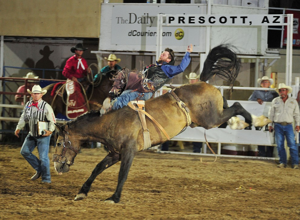 Grant Denny scores 73 on Dusty Valley in the bareback during the opening performance of the Prescott Frontier Days Rodeo Thursday, June 28, 2018. (Les Stukenberg/Courier)