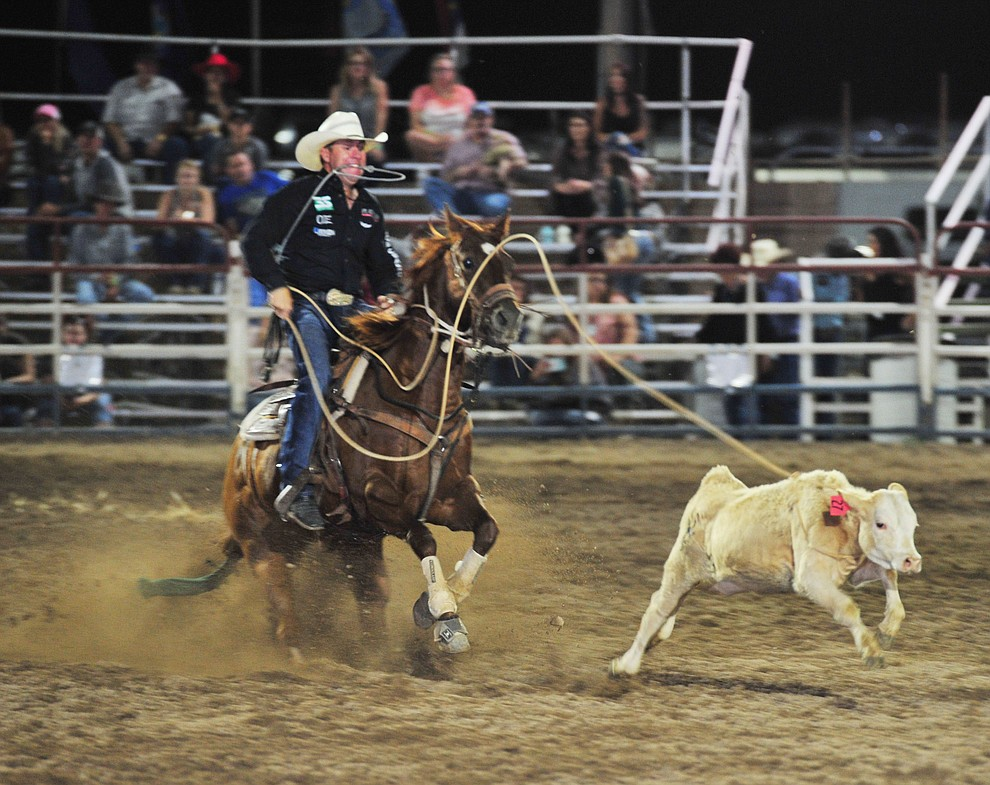 Trevor Brazile ropes his calf in the tie down roping during the opening performance of the Prescott Frontier Days Rodeo Thursday, June 28, 2018. (Les Stukenberg/Courier)