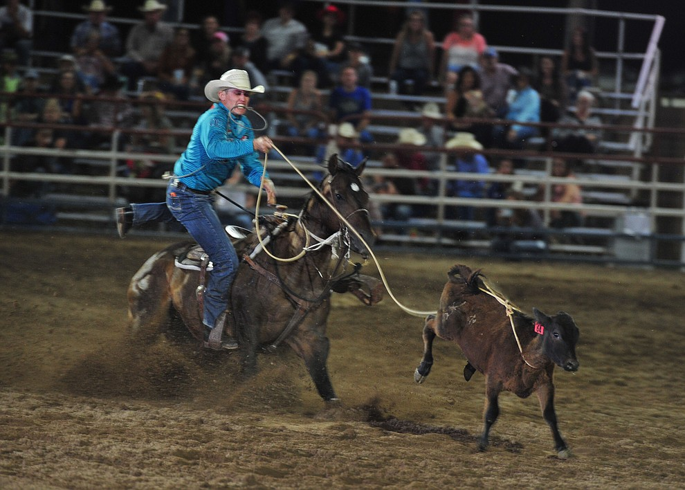 Tuf Cooper ropes his calf in the tie down roping during the opening performance of the Prescott Frontier Days Rodeo Thursday, June 28, 2018. (Les Stukenberg/Courier)
