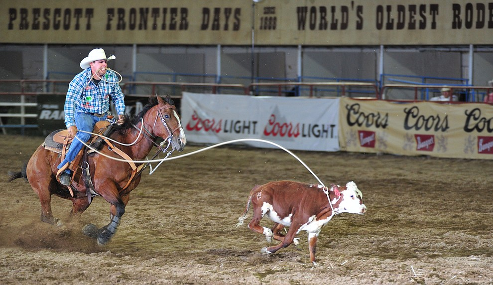Randall Carlisle ropes his calf in the tie down roping during the opening performance of the Prescott Frontier Days Rodeo Thursday, June 28, 2018. (Les Stukenberg/Courier)