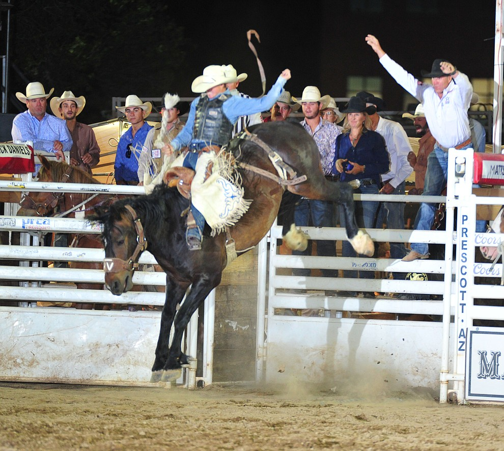 Sage Newman rides Happy Valley in the saddle bronc during the opening performance of the Prescott Frontier Days Rodeo Thursday, June 28, 2018. (Les Stukenberg/Courier)