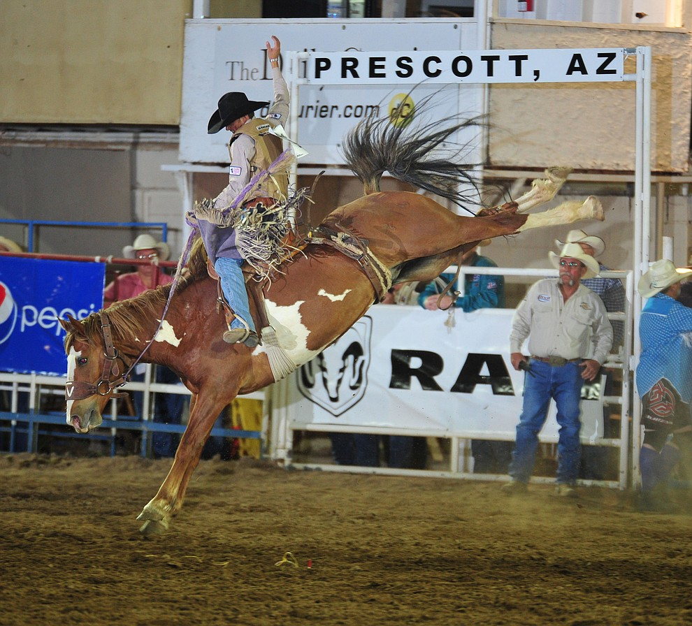 Hardy Braden rides Tami's Jammis for a score of 73 during the opening performance of the Prescott Frontier Days Rodeo Thursday, June 28, 2018. (Les Stukenberg/Courier)
