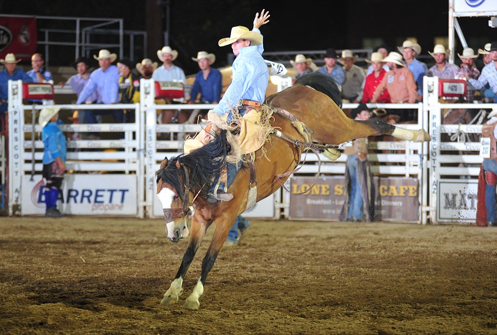 Jake Barnes rides I'ma Be for a score of 74 in the saddle bronc during the opening performance of the Prescott Frontier Days Rodeo Thursday, June 28, 2018. (Les Stukenberg/Courier)