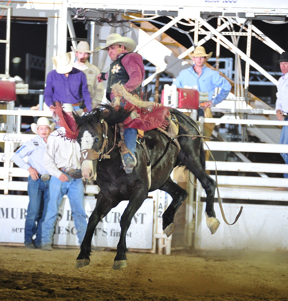 Audy Reed rides Moonlight for a score of 80 in the saddle bronc during the opening performance of the Prescott Frontier Days Rodeo Thursday, June 28, 2018. (Les Stukenberg/Courier)