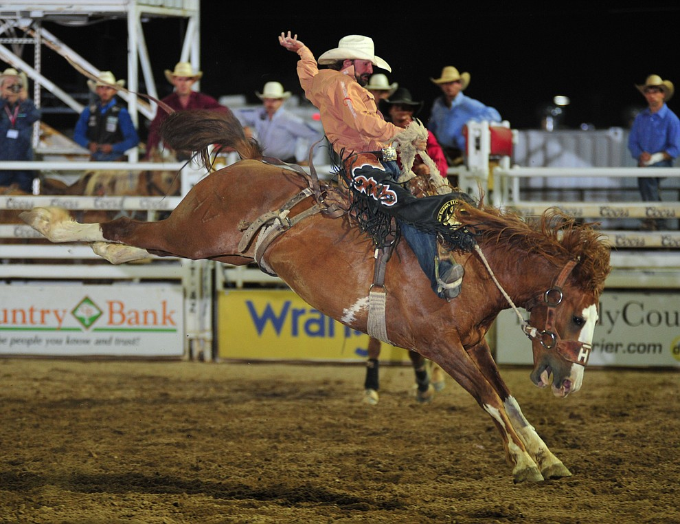 Wade Sundell rides Sombrero for a score of 82.5 in the saddle bronc during the opening performance of the Prescott Frontier Days Rodeo Thursday, June 28, 2018. (Les Stukenberg/Courier)