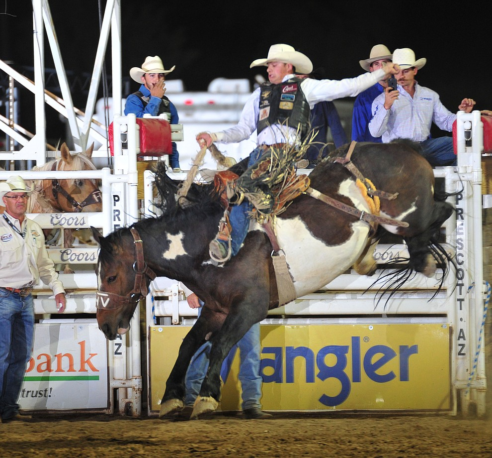 Lefty Holman rides Table Talk in the saddle bronc during the opening performance of the Prescott Frontier Days Rodeo Thursday, June 28, 2018. (Les Stukenberg/Courier)