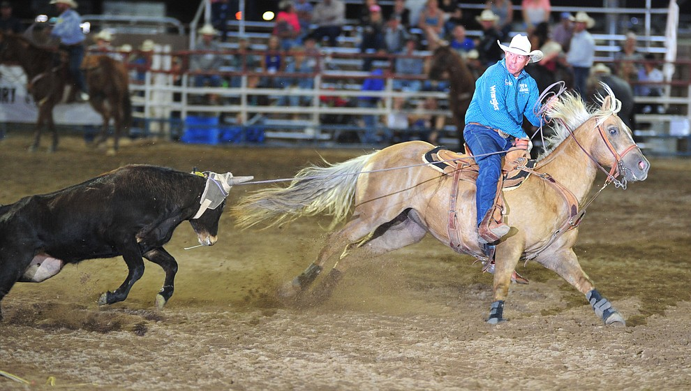 Jake Barnes ropes his steer in the team roping during the opening performance of the Prescott Frontier Days Rodeo Thursday, June 28, 2018. (Les Stukenberg/Courier)