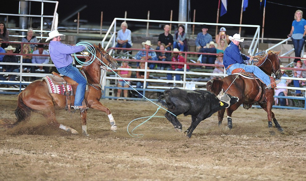 Charlie Crawford and Ty Arnold had a fast 5.4 second run the team roping during the opening performance of the Prescott Frontier Days Rodeo Thursday, June 28, 2018. (Les Stukenberg/Courier)