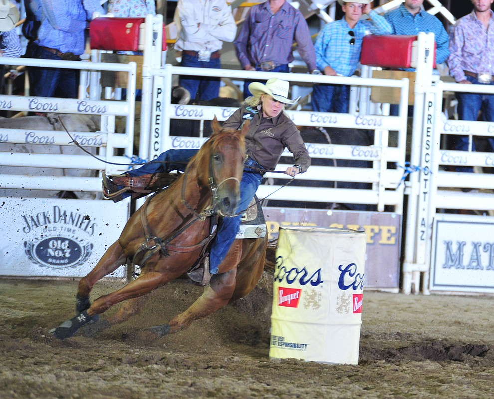 Kylie Weast had a 17.65 second run in the barrel race during the opening performance of the Prescott Frontier Days Rodeo Thursday, June 28, 2018. (Les Stukenberg/Courier)