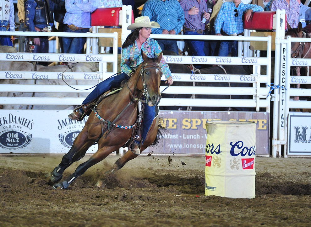 Andrea Busby had a 22.71 seocnd run with a penalty in the barrel race during the opening performance of the Prescott Frontier Days Rodeo Thursday, June 28, 2018. (Les Stukenberg/Courier)