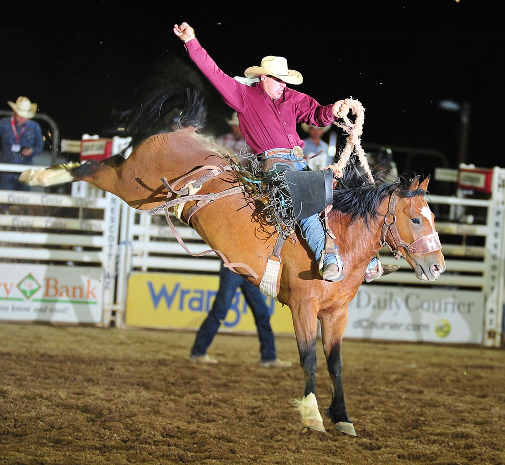 Jade Blackwell scores 80.5 on his reride in the saddle bronc during the opening performance of the Prescott Frontier Days Rodeo Thursday, June 28, 2018. (Les Stukenberg/Courier)