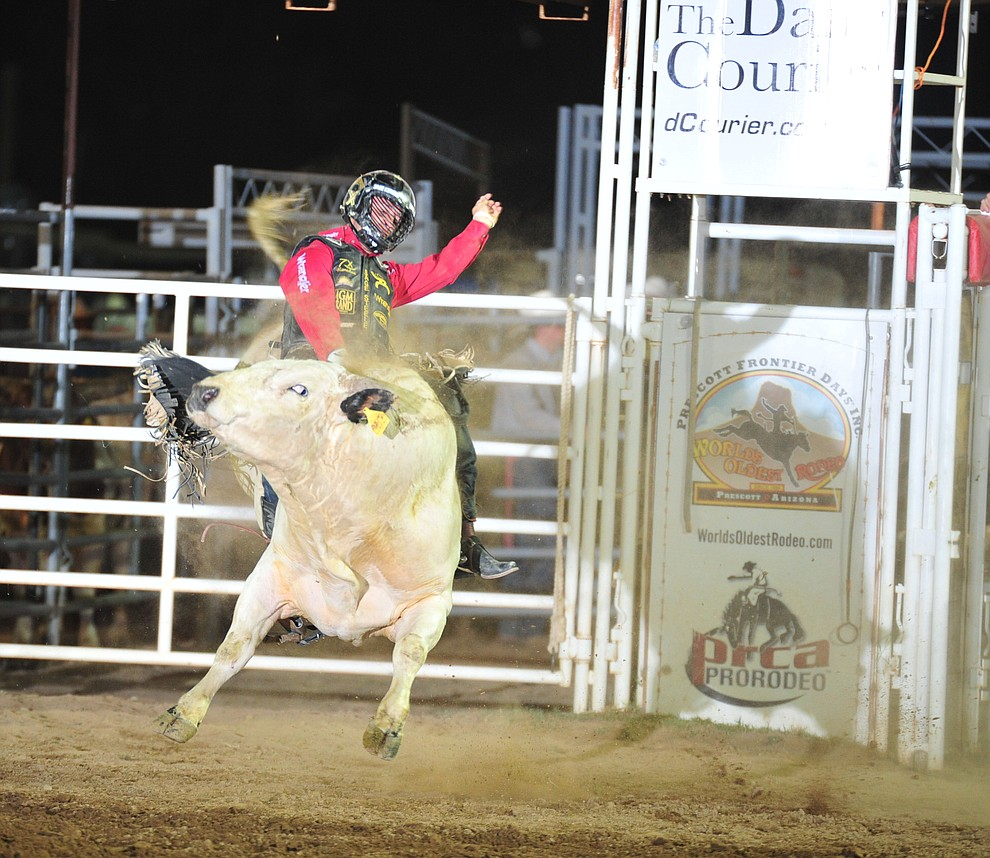 Sage Kimzey on Little Turbo in the bull riding during the opening performance of the Prescott Frontier Days Rodeo Thursday, June 28, 2018. (Les Stukenberg/Courier)