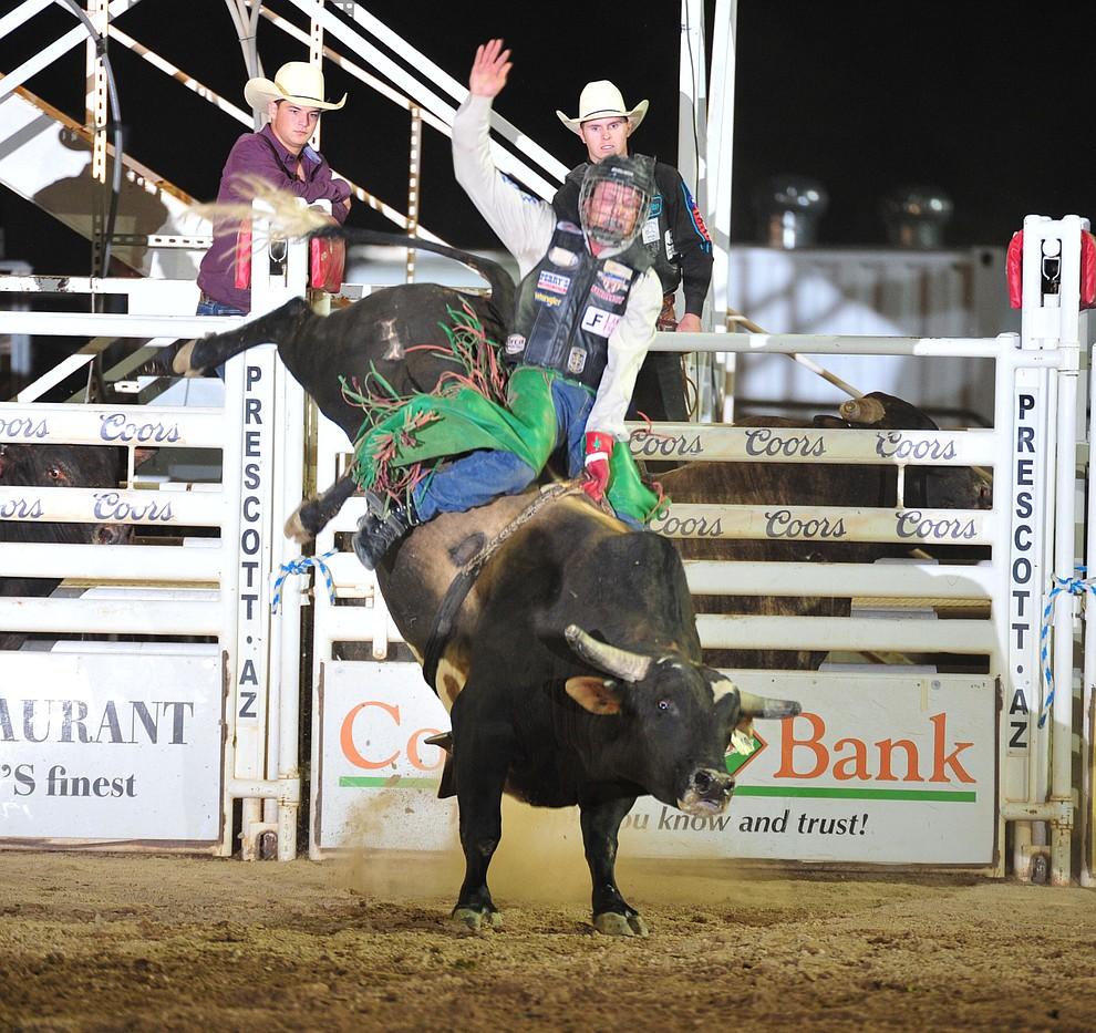 Josh Frost on Pistol Packin Ma in the bull riding during the opening performance of the Prescott Frontier Days Rodeo Thursday, June 28, 2018. (Les Stukenberg/Courier)