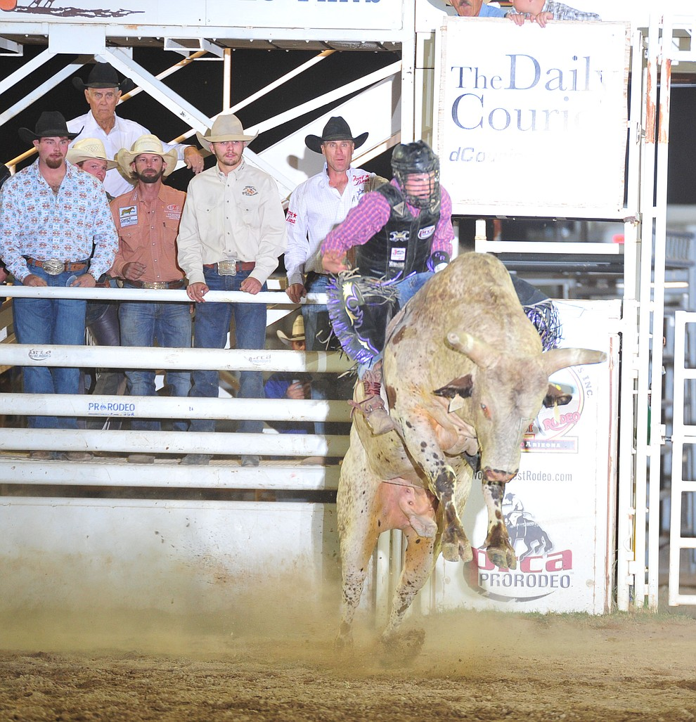 Colt Robinson on Yikes in the bull riding during the opening performance of the Prescott Frontier Days Rodeo Thursday, June 28, 2018. (Les Stukenberg/Courier)