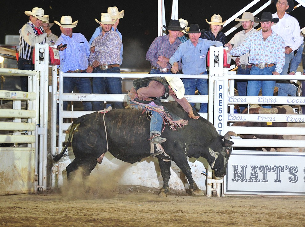 Elliot Jacoby on Rustlers Roost in the bull riding during the opening performance of the Prescott Frontier Days Rodeo Thursday, June 28, 2018. (Les Stukenberg/Courier)