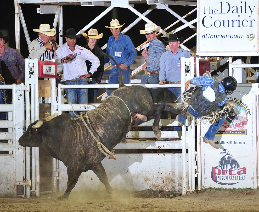 Tyler Taylor gets ejected by House of Pain in the bull riding during the opening performance of the Prescott Frontier Days Rodeo Thursday, June 28, 2018. (Les Stukenberg/Courier)