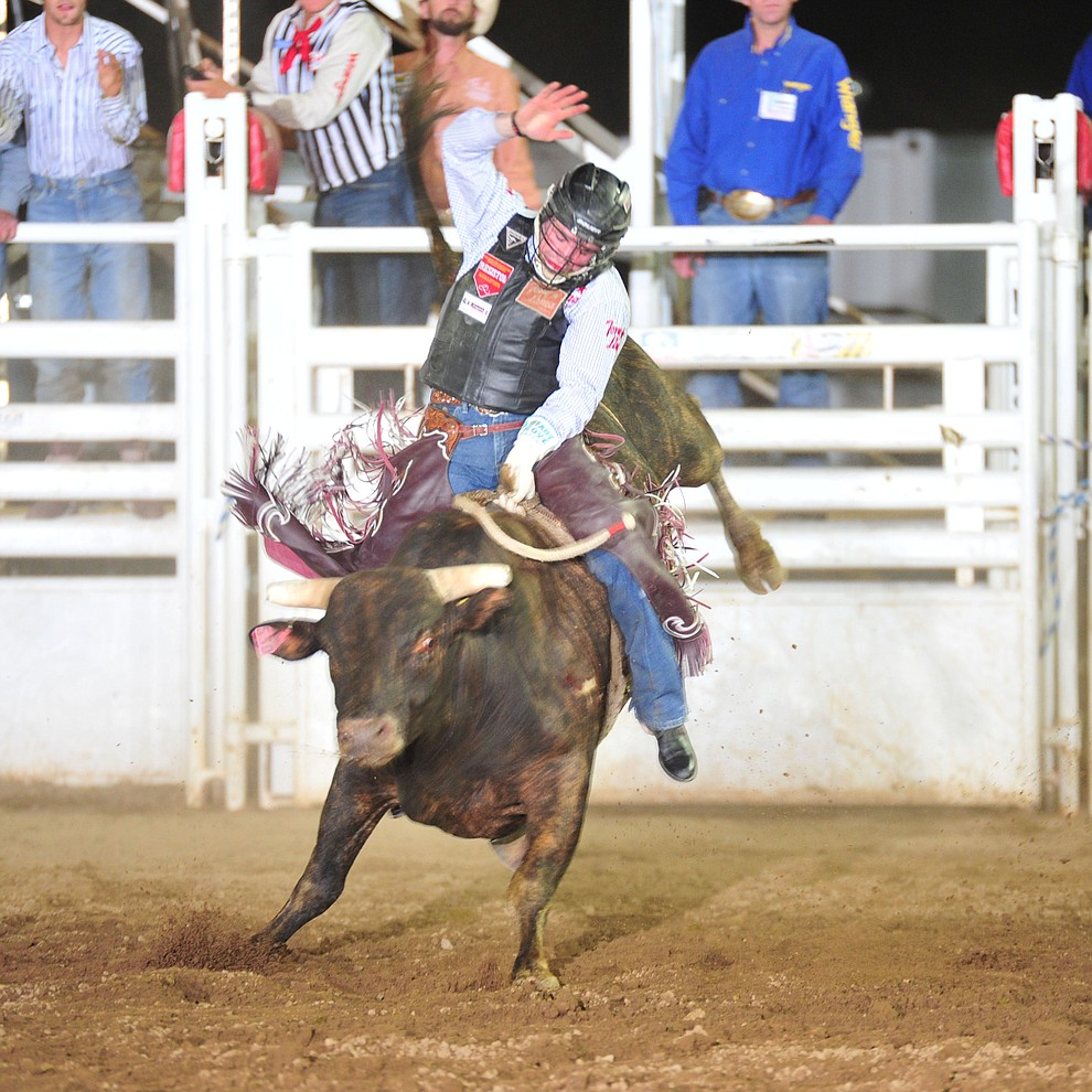 Ty Wallace scored 80 on Cowboyd in the bull riding during the opening performance of the Prescott Frontier Days Rodeo Thursday, June 28, 2018. (Les Stukenberg/Courier)