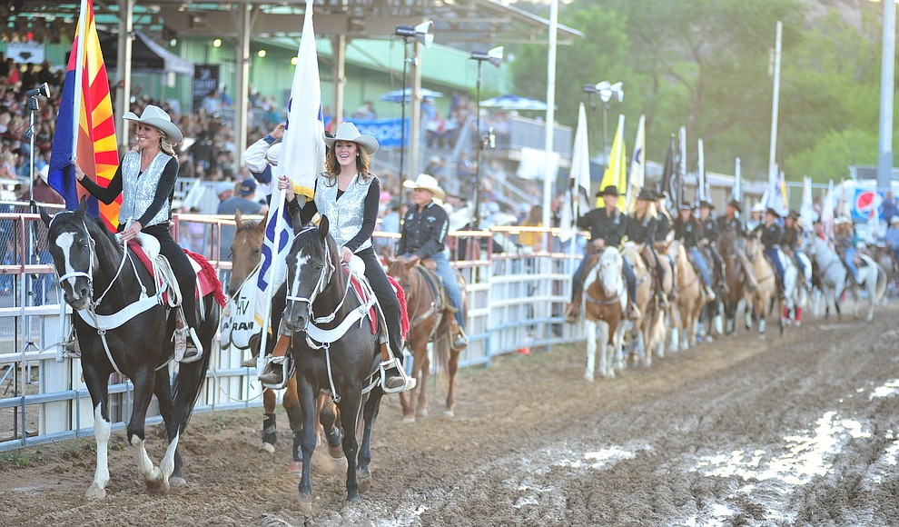 The Grand Entry during the second performance of the Prescott Frontier Days Rodeo Friday, June 29, 2018.(Les Stukenberg/Courier)