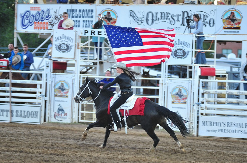 Sami Kilduff brings in Old Glory during the second performance of the Prescott Frontier Days Rodeo Friday, June 29, 2018.(Les Stukenberg/Courier)