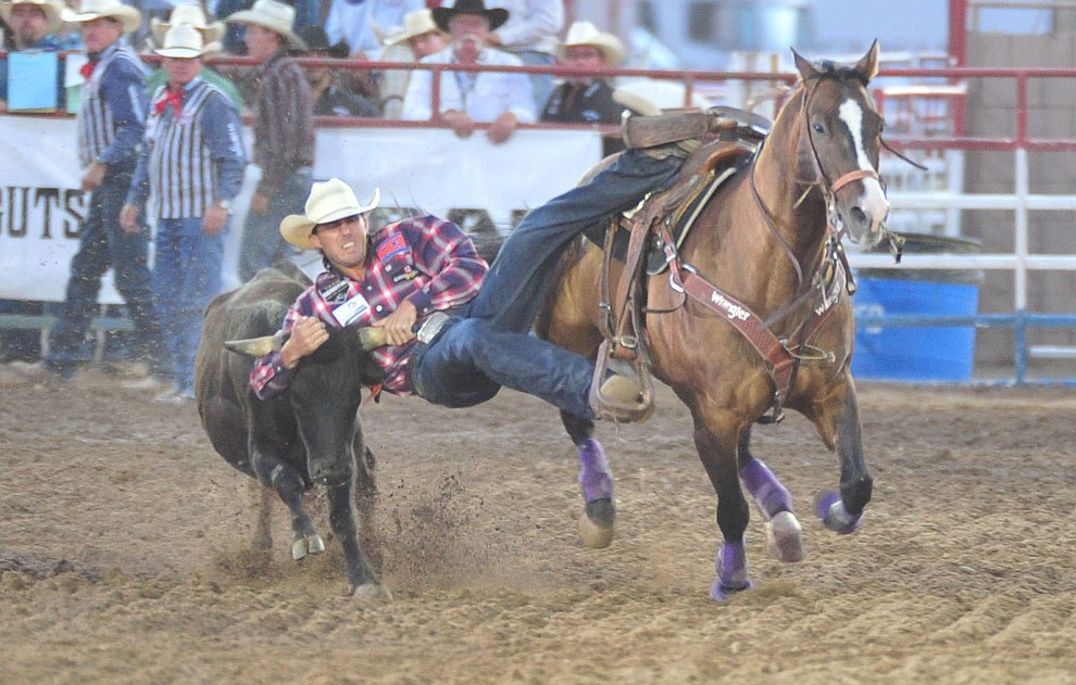 Timmy Sparing had a 5.8 second run in the steer wrestling during the second performance of the Prescott Frontier Days Rodeo Friday, June 29, 2018.(Les Stukenberg/Courier)