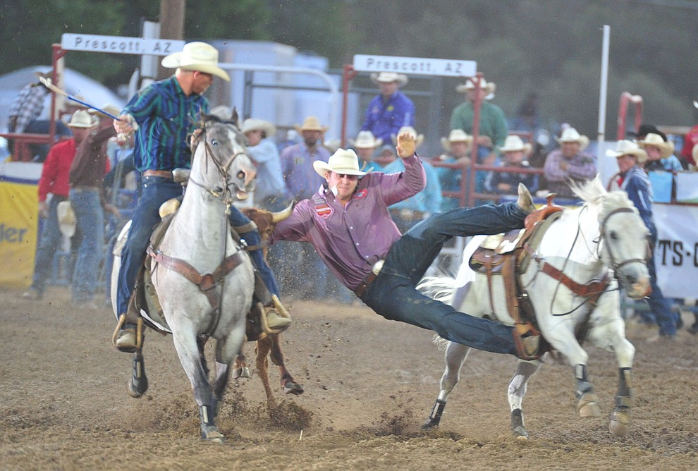 JD Struxness reaches for his steer in the steer wrestling during the second performance of the Prescott Frontier Days Rodeo Friday, June 29, 2018.(Les Stukenberg/Courier)