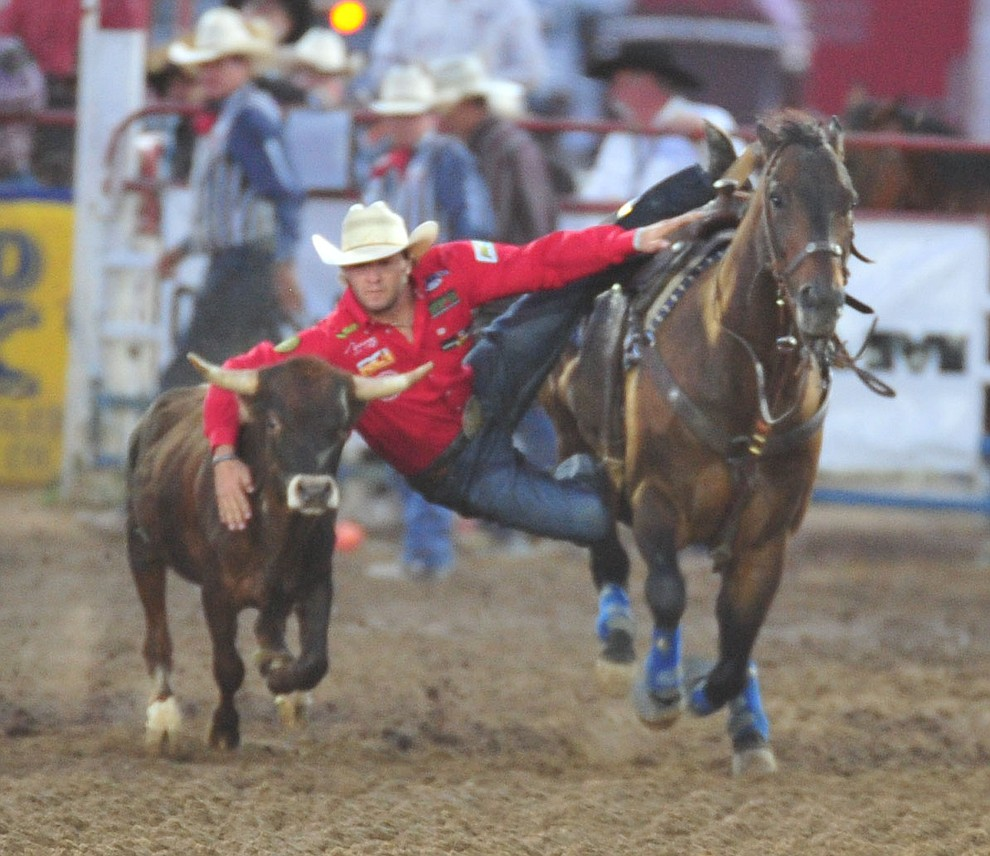 Rowdy Parrott had a 6.1 second run in the steer wrestling during the second performance of the Prescott Frontier Days Rodeo Friday, June 29, 2018.(Les Stukenberg/Courier)