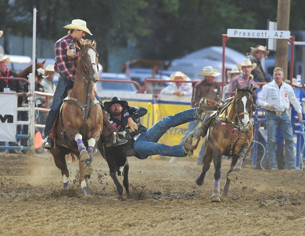 Clayton Haas had a 5.2 second run in the steer wrestling during the second performance of the Prescott Frontier Days Rodeo Friday, June 29, 2018.(Les Stukenberg/Courier)