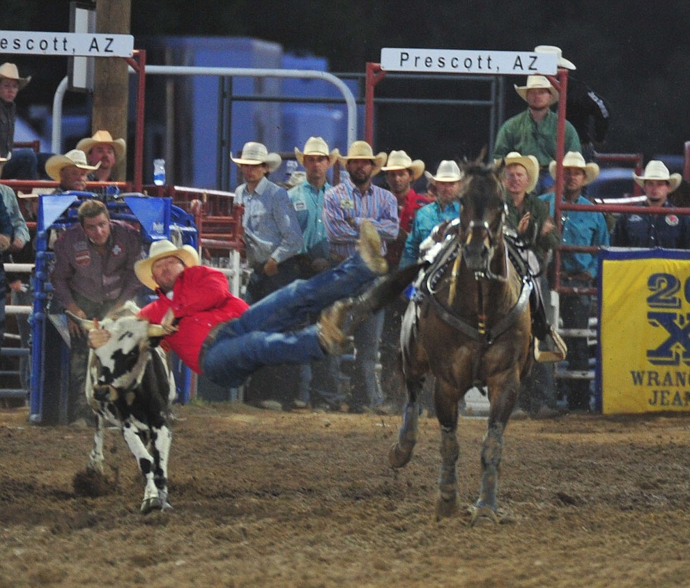 Cimarron Thomson reaches out in the steer wrestling during the second performance of the Prescott Frontier Days Rodeo Friday, June 29, 2018.(Les Stukenberg/Courier)