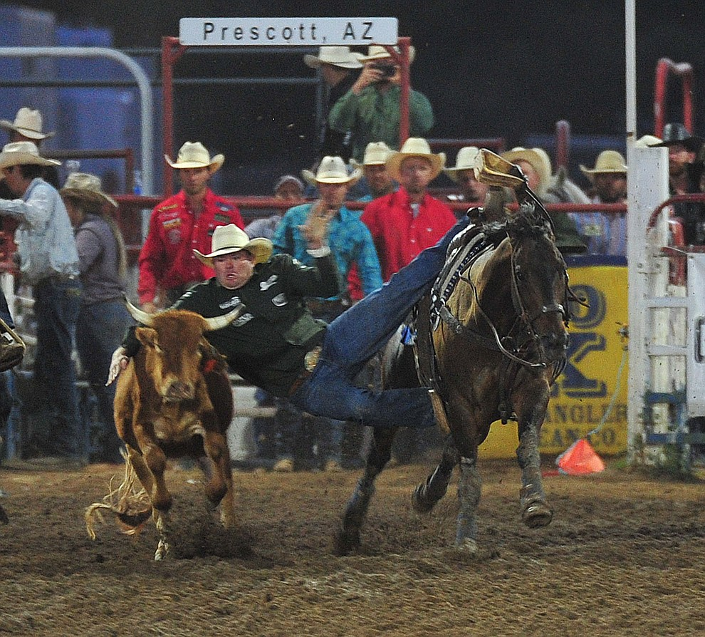 Hunter Cure drops down in the steer wrestling during the second performance of the Prescott Frontier Days Rodeo Friday, June 29, 2018.(Les Stukenberg/Courier)