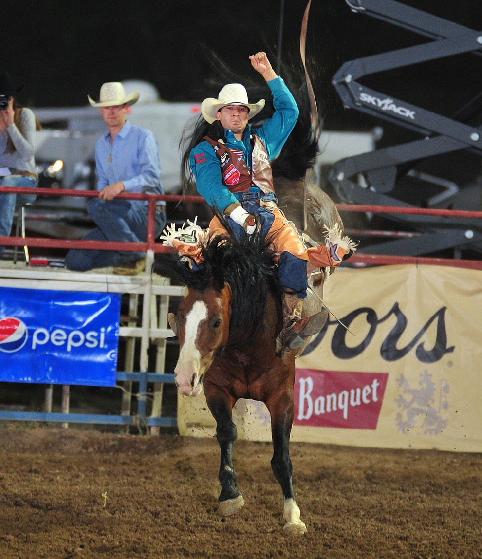 Jake Brown score 86.5 on Karate Hottie in the bareback during the second performance of the Prescott Frontier Days Rodeo Friday, June 29, 2018.(Les Stukenberg/Courier)