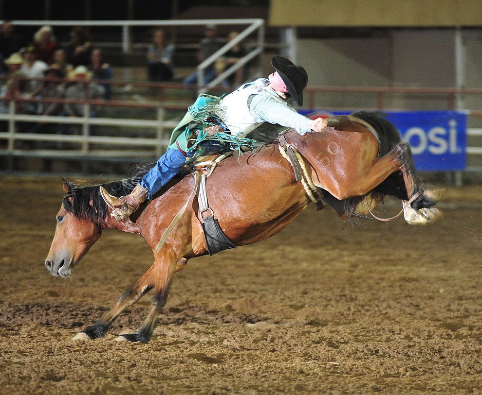 Zach Hibler scores 77 on Olivia Pope in the bareback during the second performance of the Prescott Frontier Days Rodeo Friday, June 29, 2018.(Les Stukenberg/Courier)