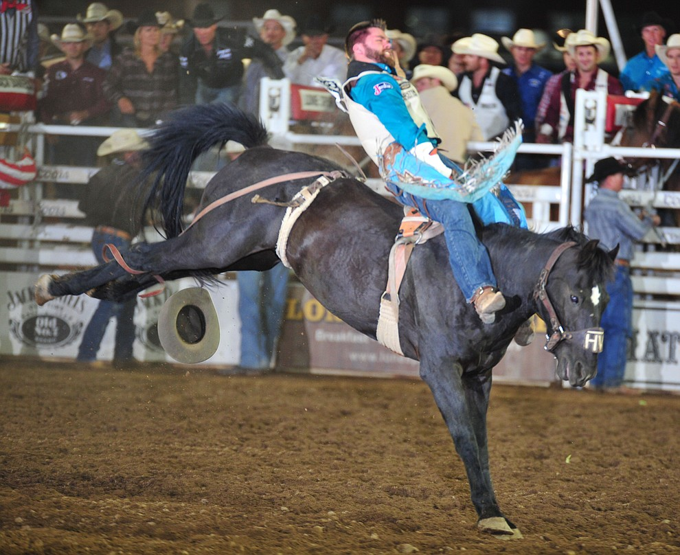 Luke Creasy scores 75 on Pine Cone in the bareback during the second performance of the Prescott Frontier Days Rodeo Friday, June 29, 2018.(Les Stukenberg/Courier)