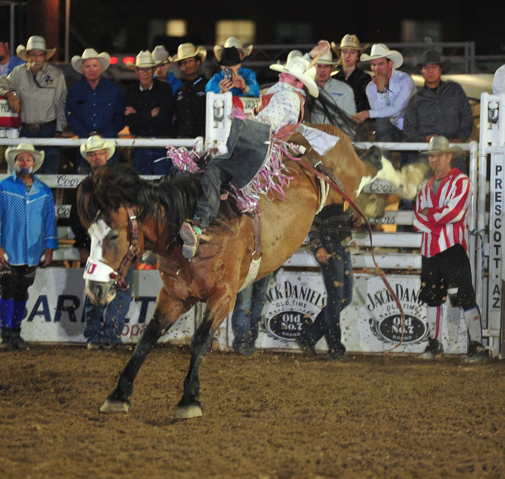 Hunter Brasfield scores 80.5 on Big Valley in the bareback during the second performance of the Prescott Frontier Days Rodeo Friday, June 29, 2018.(Les Stukenberg/Courier)