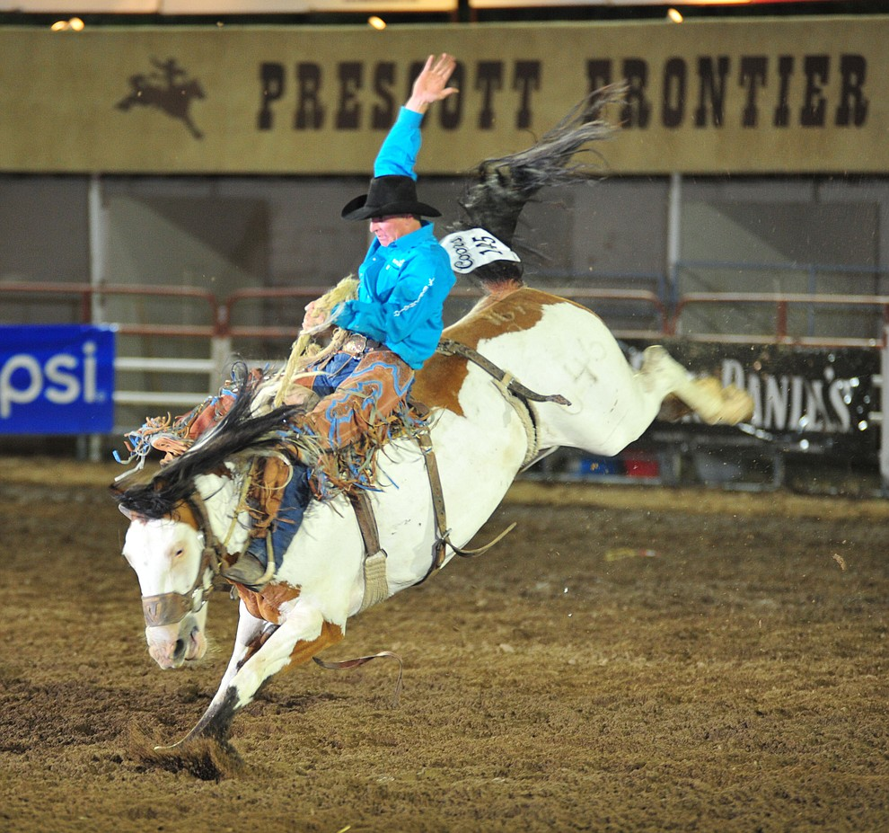 Josh Davison scores 72 on Painted Coast in the saddle bronc during the second performance of the Prescott Frontier Days Rodeo Friday, June 29, 2018.(Les Stukenberg/Courier)
