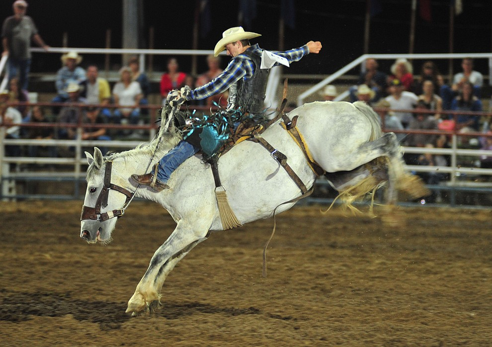 Roper Kiesner scores 65 on Betty White in the saddle bronc during the second performance of the Prescott Frontier Days Rodeo Friday, June 29, 2018.(Les Stukenberg/Courier)