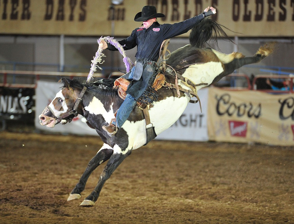 Sterling Crawley scores 73 on Double Valley in the saddle bronc during the second performance of the Prescott Frontier Days Rodeo Friday, June 29, 2018.(Les Stukenberg/Courier)