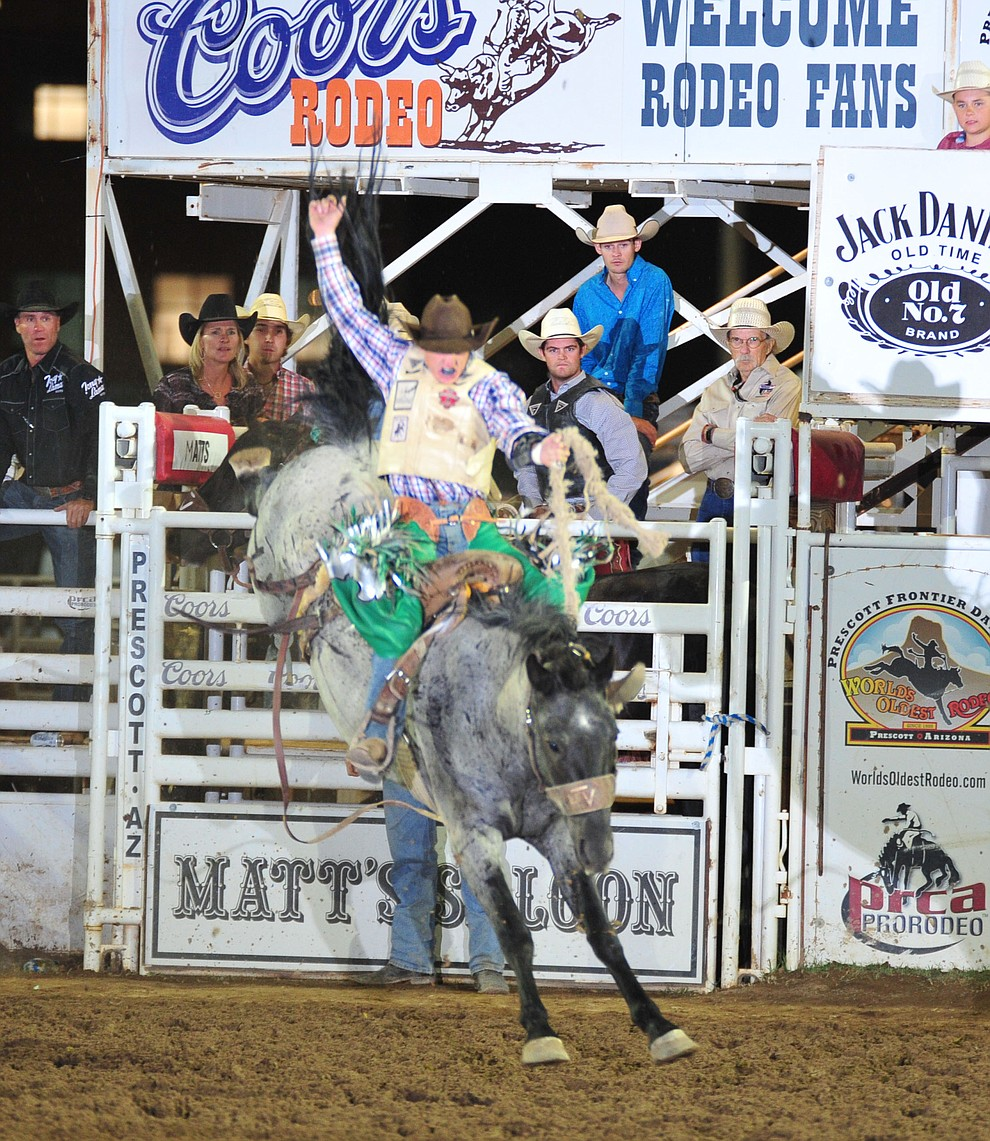 Allen Boore scores 73 on Blue Swan in the saddle bronc during the second performance of the Prescott Frontier Days Rodeo Friday, June 29, 2018.(Les Stukenberg/Courier)