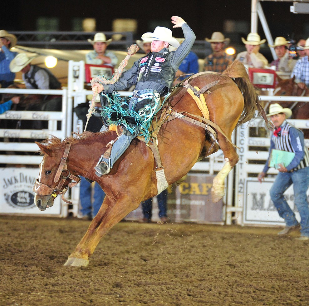 Jacobs Crawley scores 79 on Ring Binder in the saddle bronc during the second performance of the Prescott Frontier Days Rodeo Friday, June 29, 2018.(Les Stukenberg/Courier)