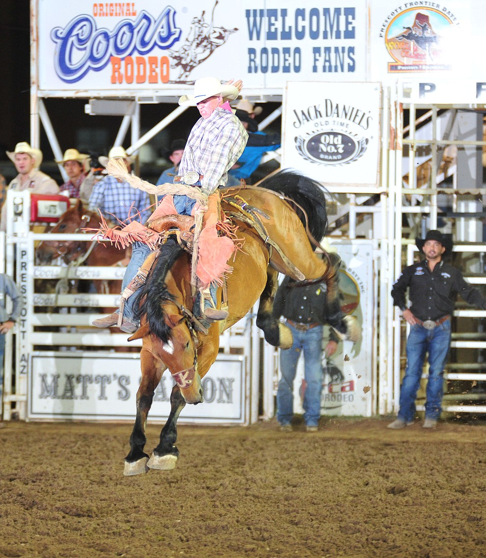 Tom Knight scores 76 on Dakota Babe in the saddle bronc during the second performance of the Prescott Frontier Days Rodeo Friday, June 29, 2018.(Les Stukenberg/Courier)