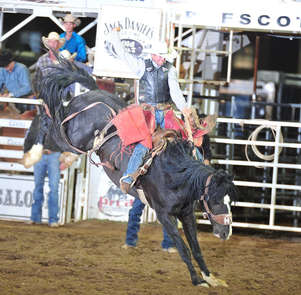 Toby Collins on Julio in the saddle bronc during the second performance of the Prescott Frontier Days Rodeo Friday, June 29, 2018.(Les Stukenberg/Courier)