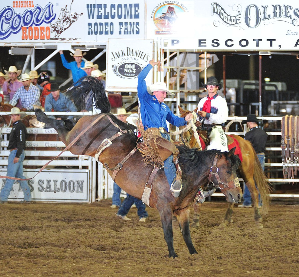 Ross Griffin scored 80 on Frisky Chicken in the saddle bronc during the second performance of the Prescott Frontier Days Rodeo Friday, June 29, 2018.(Les Stukenberg/Courier)
