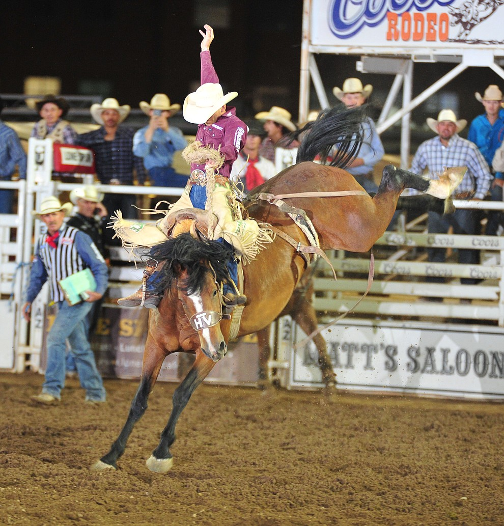 Joe Lufkin on Sun Glow in the saddle bronc during the second performance of the Prescott Frontier Days Rodeo Friday, June 29, 2018.(Les Stukenberg/Courier)