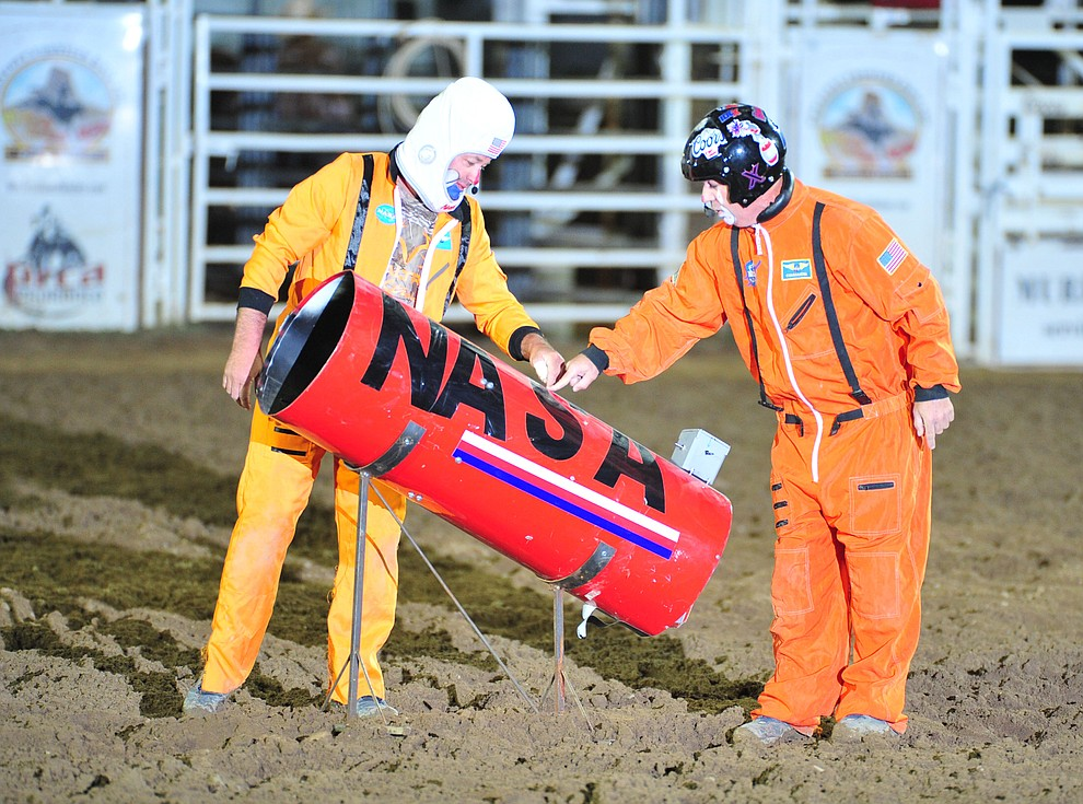 Luke Kraut and Robbie Hodges perform an act during the second performance of the Prescott Frontier Days Rodeo Friday, June 29, 2018.(Les Stukenberg/Courier)