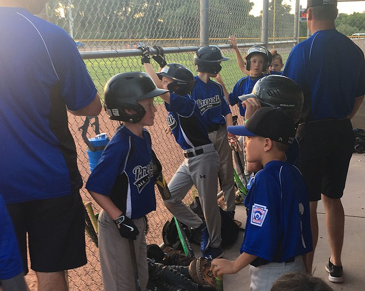 Players for the Prescott Minors All-Stars get ready to play in the dugout before a District 10 Minors All-Stars Tournament game June 19 in Williams. (PLL/Courtesy)