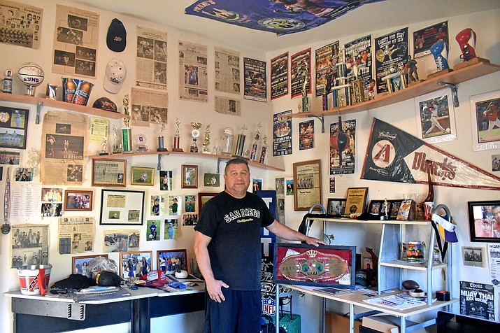 Richard Williams holds his championship belt in his trophy room at his home in Camp Verde. VVN/Halie Chavez