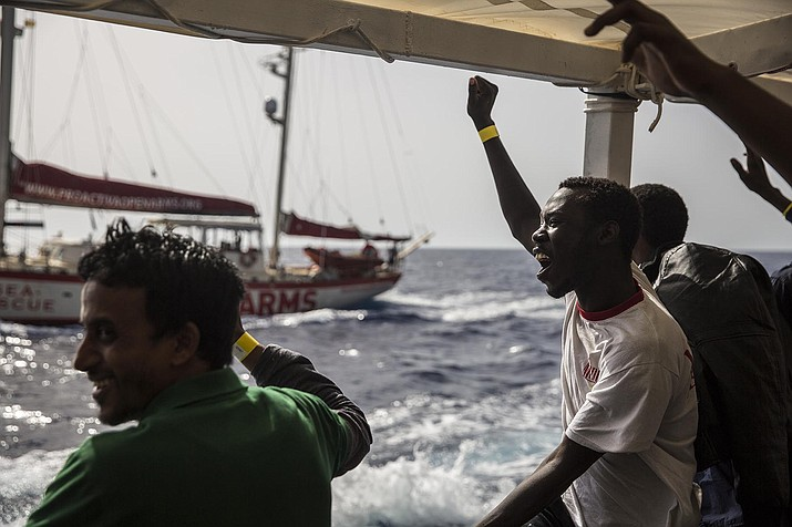 "Migrants rescued from a rubber dinghy off the Libyan coast rejoice aboard the Open Arms aid boat, of Proactiva Open Arms Spanish NGO, Saturday, June 30, 2018. 60 migrants were rescued as Italy's right-wing Interior Minister Matteo Salvini tweeted: ""They can forget about arriving in an Italian port."" (AP Photo/Olmo Calvo)"