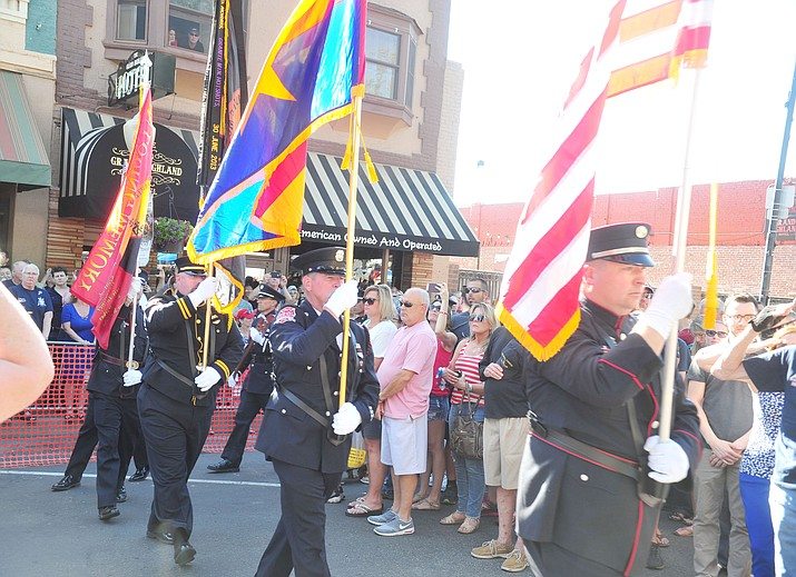 A joint fire service honor guard posts the colors during a Remembrance Ceremony for the 19 Granite Mountain Hotshots in 2018 on Montezuma Street in downtown Prescott. (Les Stukenberg/Courier, file)